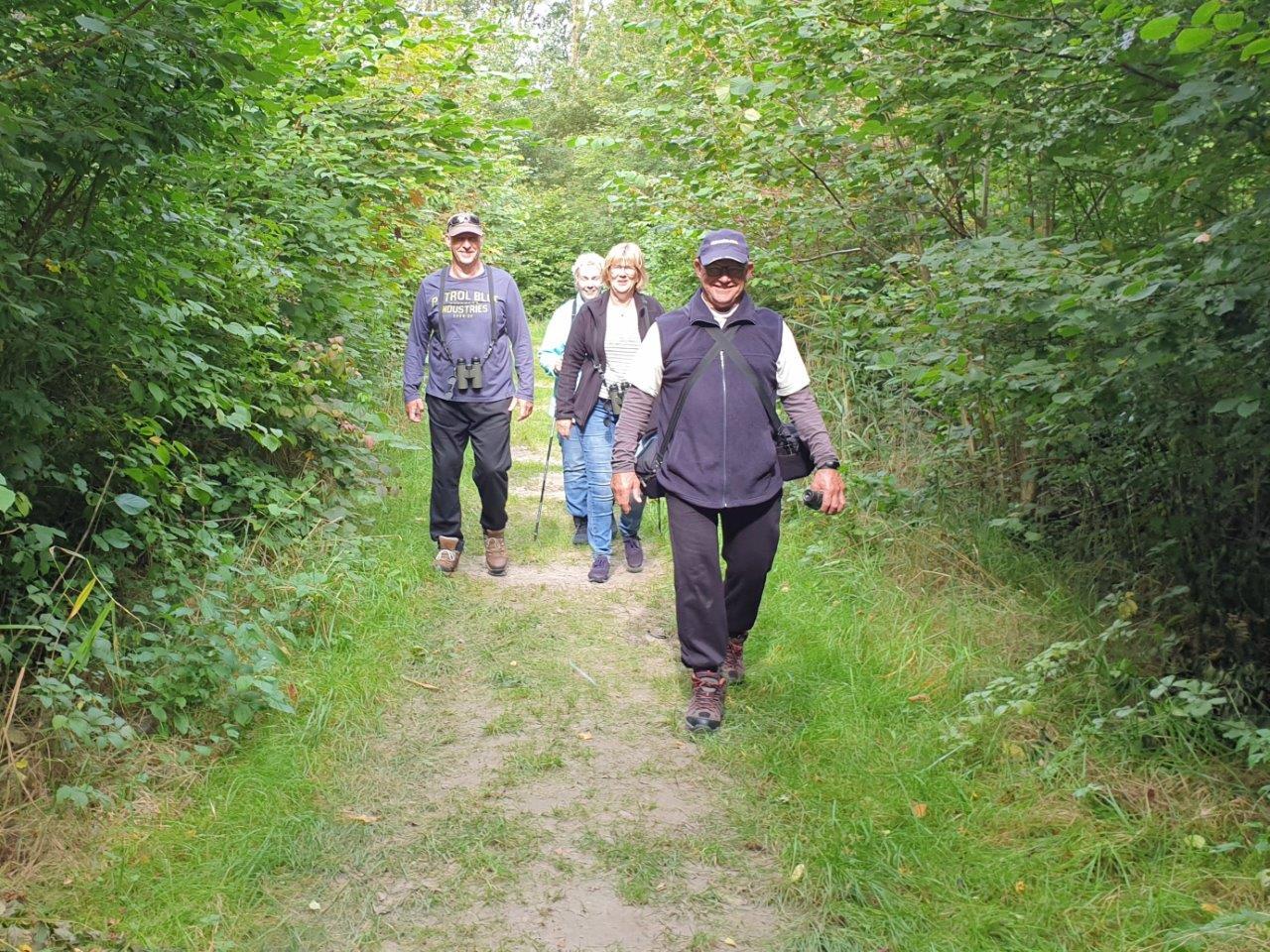 Deelnemers in het bos