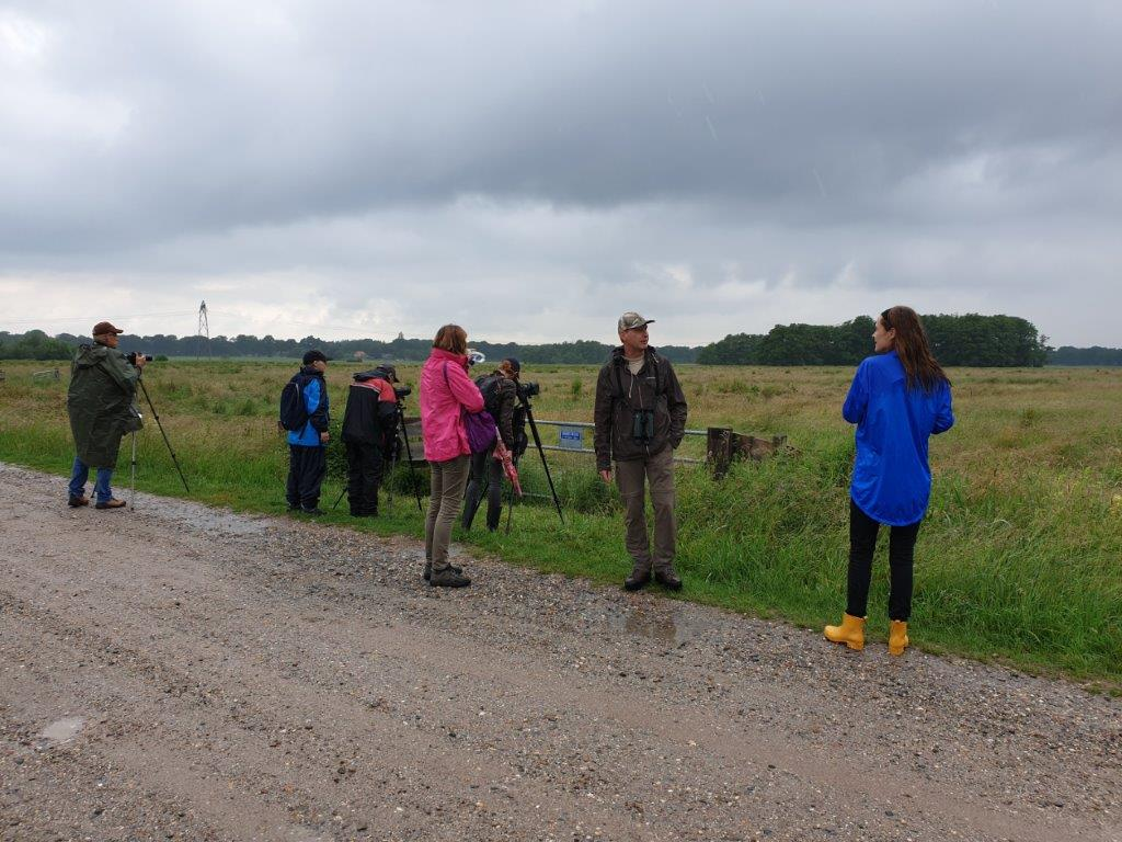 Deelnemers in de regen